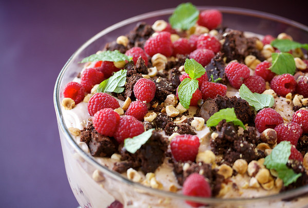 Nutella-yogurt mousse with brownie chunks, raspberries and toasted hazelnuts